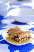 A piece of cranberry cake with butter sauce