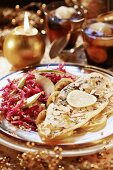Fish with almonds on bed of lemon with red cabbage salad