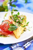 Fried Camembert with herbs and tomato