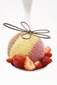 A scoop of Neapolitan ice cream with fresh strawberries