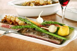 Minute steak with pearl onion sauce and vegetables