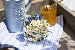 Mug, posy of bellis flowers & oilseed rape honey on a tray