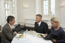 Business people having a meeting over a meal