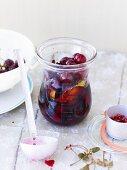 Pepper cherries in a preserving jar