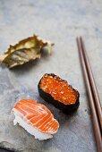 Nigiri sushi with salmon and a salmon caviar maki (Japan)