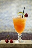 Aperol cocktail (Aperol, lime juice, passion fruit puree, apple juice, cranberry juice and cinnamon)