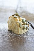 Pumpkin seed roll on a wooden surface