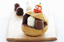 A bread roll filled with chocolate marshmallows
