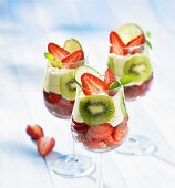 Strawberries with cream and kiwis