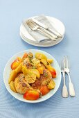 Oven baked chicken legs with apples, nectarines and garlic