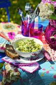 A mixed leaf salad with peas on a garden table