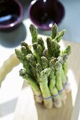 A bunch of asparagus on a chopping board