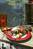 Grilled vegetable kebabs with haloumi