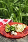 Grilled squid with limes, parsley and sauce