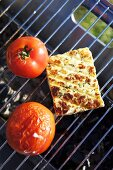 Cheese and tomatoes on a barbeque