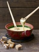 Swiss cheese fondue with cubes of wheat and rye bread