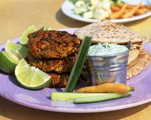 Vegetable burgers with minted yoghurt and pitta bread