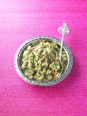 Minted onion chutney in a dish with a spoon