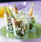 Turkey salad with nuts in four glasses