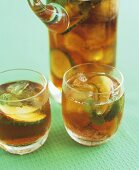 Cider Pimm's in a carafe and three glasses
