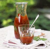 Tomato sauce in carafe and glass