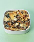 Savoury bread & butter pudding with goat's cheese & spinach