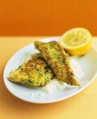 Fried fish in herb coating on cauliflower puree