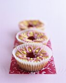 Three muffins with iced flowers