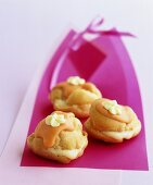Choux pastries with orange icing