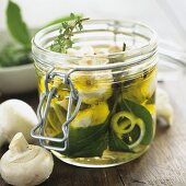 Button mushrooms preserved in oil