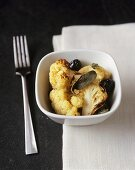 Oven-baked cauliflower with sage and olives