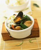 Green seafood curry with spinach and rice
