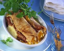 Palatschinken (filled pancakes) filled with curd cheese & apricots