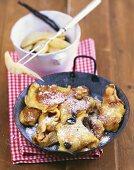 Kaiserschmarrn (chopped pancake) with raisins, vanilla pears
