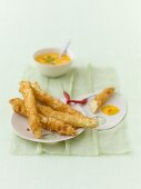 Deep-fried asparagus in coconut batter with mango dip