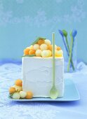 Citrus fruit ice cream with melon balls