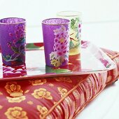 Colourful drinking glass on tray