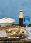 Braised chicken with beer, India