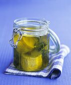 Goat's cheese in olive oil in a preserving jar