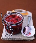 Baked raspberry jam in a preserving jar