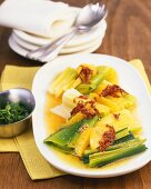 Marinated leeks with oranges and dried tomatoes