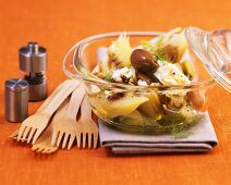 Fennel with feta cheese and olives in glass dish