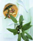 Tomato & artichoke soup with ramsons (wild garlic) & lamb fillet