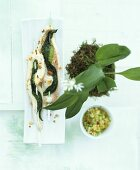 Skewered sole fillets & ramsons with nuts & melon salsa