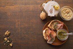 Toasted bread with ham, pumpkin pesto and walnut pesto