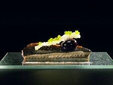 Eel, beetroot, pork rind and lobster powder (molecular gastronomy)