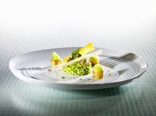 Parsley risotto, caper hachee, bananas, carob bread (molecular gastronomy)