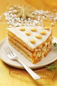A piece of marzipan cake with orange marmalde for Christmas