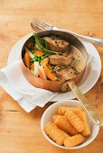 Pork medallions with pepper sauce and garden vegetables