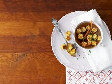 Game soup with quails' egg croutons